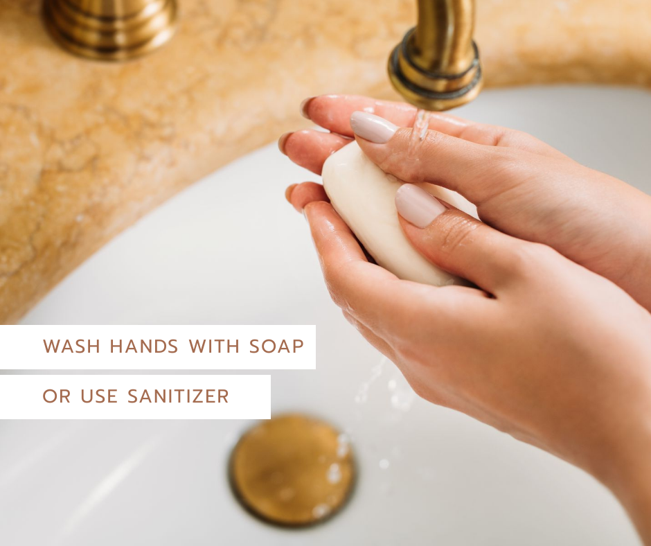 Image of a woman washing her hands with soap and the text Wash your hands with soap or use  sanitizer